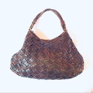 HOBO Woven leather handbag design twisted handle